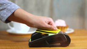 NFC contactless payment with credit card in cafe stock footage
