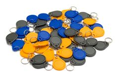 NFC Key chains. Bulk of NFC key chains against white background Stock Image