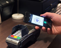 NFC - Near field communication / easy pay. The new way to pay. NFC payments via mobile phone, etc Royalty Free Stock Photo