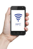 NFC near field communication. Hand holding smartphone Stock Photo