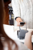 NFC Payment Using Mobile Phone Royalty Free Stock Photo
