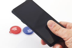 Nfc Tags. Wireless phone connection Stock Photos