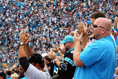 NFL - excited clapping fans! Stock Photography