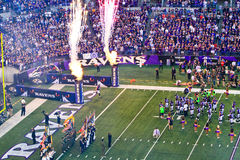 NFL Football Flags, Flames and Fireworks!. Baltimore Ravens fans in M&T Bank Stadium look on at the pre game show festivities as players from the home team Stock Photography