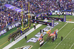 NFL Football Pre Game Festivities. Baltimore Ravens fans in M&T Bank Stadium look on at the pre game festivities, including the color guard and marching band stock photography