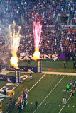 NFL Football Pre Game Fireworks!. Baltimore Ravens fans in M&T Bank Stadium look on at the pre game show festivities as players from the home team Ravens run out Royalty Free Stock Images
