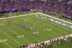 NFL Football Red Zone Shotgun Snap. Baltimore Ravens Joe Flacco takes the snap from center out of the shotgun outduring a Monday night NFL football game between Stock Photography