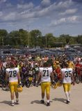 NFL Football Tradition, Green Bay Packers. Players from the Green Bay Packers partaking in the tradition of borrowing bikes from kids in order to ride to the royalty free stock photography
