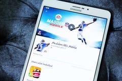 Nfl madden mobile game app. Downloading nfl madden mobile game on samsung tablet royalty free stock image