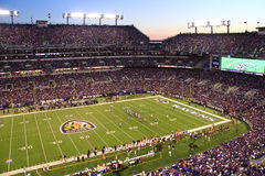 NFL Monday Night Football Twilight in Baltimore. Baltimore Ravens fans fill M&T Bank Stadium and look on during a drive by the Bengals from deep in their own Royalty Free Stock Photography