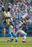 NFL:  Oct 09 Saints Vs Panthers. CHARLOTTE, NC - OCT 09, 2011:  Saints Linebacker, Jonathan Vilma, is flipped while Panthers Quaterback, Cam Newton, sets up to