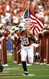 Nfl Player Holding U.s.a. Flag on Field Royalty Free Stock Photography