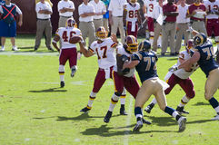 NFL Pro Football. Washington Redskins quaterback Jason Campbell sets to throw the ball against the St. Louis Rams defense Stock Photos