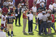 NFL Pro Football. THe Washington Redskins coach Jim Zoran shakes hand with St. Louis Rams coach Steve Spagnuola after the game Royalty Free Stock Images