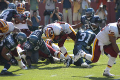 NFL Pro Football. NFL's National Football league Washington Redskins Clinton Portis rushes against the Seattle Seahawks Royalty Free Stock Photos