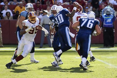 NFL Pro Football. NFL's Washington Redskins defense rushes Tennessee Titan's Quarterback during a season game between the two Royalty Free Stock Images