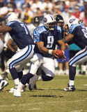 NFL Quarterback Steve McNair. Sep 27, 2004 - Tennessee Titans' Quarterback, Steve McNair, prepares to hand off to his running backs during their game against the Royalty Free Stock Photography