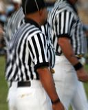 NFL Referees. Contemplating decisions is a complicated task especially when it is done by a panel rather than an individual Royalty Free Stock Image