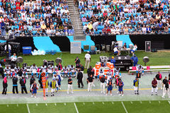 NFL - sideline and fans in the stands Stock Images