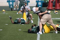 NFL Training Camp, Workout, Exercise. Players from the Green Bay Packers stretch and warm up before practice. Scene from training camp as players exercise and do royalty free stock photos