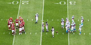 NFL - two teams in the huddle Royalty Free Stock Images