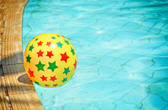 Nflatable ball floating in swimming pool Royalty Free Stock Photos