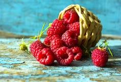 Fresh raspberries in vintage basket vitamins healthy food vegan ingredients. Selective focus. NFresh raspberries in vintage basket vitamins healthy food vegan Stock Image