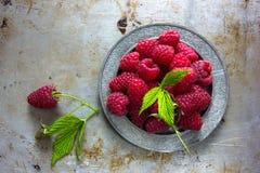 Fresh raspberries in vintage bowl vitamins healthy food vegan ingredients. Selective focus. NFresh raspberries in vintage basket vitamins healthy food vegan Royalty Free Stock Image