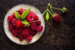 Fresh raspberries in vintage bowl vitamins healthy food vegan ingredients. Selective focus. NFresh raspberries in vintage basket vitamins healthy food vegan Royalty Free Stock Photo