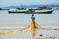 NGAPALI, MYANMAR- SEPTEMBER 25, 2016: Burmese fishermen at Bengal Bay Stock Images