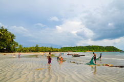 NGAPALI, MYANMAR- SEPTEMBER 25, 2016: Burmese fishermen at Bengal Bay Royalty Free Stock Photo