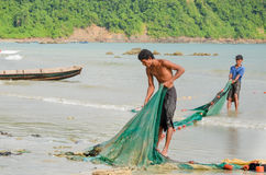 NGAPALI, MYANMAR- SEPTEMBER 25, 2016: Burmese fishermen at Bengal Bay Royalty Free Stock Photos
