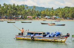NGAPALI, MYANMAR- SEPTEMBER 25, 2016: Traditional old fishing boat bringing fish from the sea Stock Image