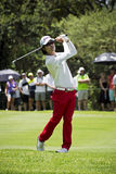 Kevin Na. Clubbing the ball up the fairway, heading to the green, on the 4th day of the tournament Royalty Free Stock Photo