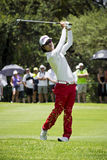 Kevin Na. Clubbing the ball up the fairway, heading to the green, on the 4th day of the tournament Stock Photo
