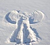 Ángel en la nieve. Fotos de archivo libres de regalías