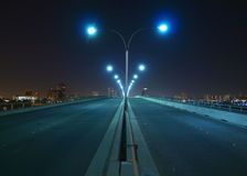 Nght bridge and towers. Empty bridge, towers and street lights at night Stock Images