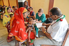 NGO Activity. A doctor examine the child health at the clinic center which is organized by a NGO,Half of India's children under the age of five are malnourished Royalty Free Stock Image
