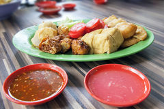 Ngo Hiang Dish with Sausage Tofu and Dipping Sauce. Ngo Hiang Five Spice Powder Seasoned Fried Sausages Tofu Fishballs Preserved Century Eggs and Dipping Sauces Stock Image