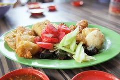 Ngo Hiang Dish with Sausage Tofu and Fishballs. Ngo Hiang Five Spice Powder Seasoned Fried Sausages Tofu Fishballs Preserved Century Eggs Local Dish Royalty Free Stock Photography