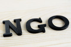 NGO letters on wood background Stock Images