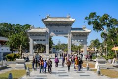 Ngong Ping Entrance gate at Lantau Island, People visit the Tian Tan or the Big Buddha located at Po Lin Monastery, landmark and stock photography