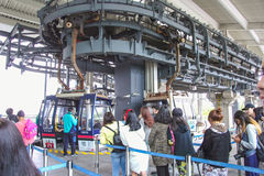 Ngong Ping Skyrail cable car gondolas round a turning junction en route to the Big Buddha and Po-Lin Monastery on Lantau Island Stock Photo