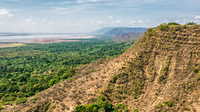 Ngorongoro Conservation Area in Tanzania, Africa. View over Ngorongoro Conservation Area with lake Magadi in Tanzania, East Africa. Ngorongoro Crater is a large stock photos