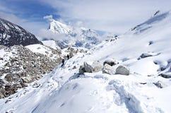 Ngozumba Glacier, Sagarmatha National Park, Nepal. Hiking group on a  trail. Ngozumba Glacier, Sagarmatha National Park, Nepal, Himalayas Stock Photos