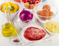 Ngredients for baked eggs with vegetables, cheese  and chorizo. Stock Image