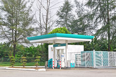 NGV Refueling Station surrounded by green trees. A natural gas vehicle NGV is an alternative fuel vehicle for autonomous mobility that uses either compressed stock photo