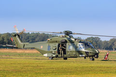 NH-90 helicopter. NH-90 transport helicopter of the Belgian Army idling on the ground with crew member in open door royalty free stock images