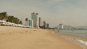 Nha Trang beach with many vacationing tourists. Vietnam. Timelapse. stock video footage