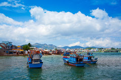 Blue boats with blue sky in Nha Trang, Vietnam. Royalty Free Stock Photo